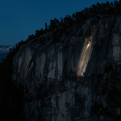 Ian Strachan climbing North Star at dusk, high up on the Chief, in Squamish, BC