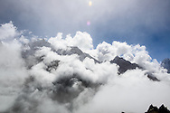 Clouds drift around high mountains in the Nepal.