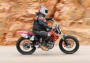 COLORADO SPRINGS - JUNE 27:  Michael Kassebaum #4 drives a 2003 Honda CRF 450R motorcycle in the 450cc Division as he races 12.42 miles up to the 14,110 foot summit of Pikes Peak Mountain in Pike National Forest during the 88th running of the Pikes Peak International Hill Climb, the second oldest motor sports event in the United States, on June 27, 2010 in Colorado Springs, Colorado. ©Paul Anthony Spinelli