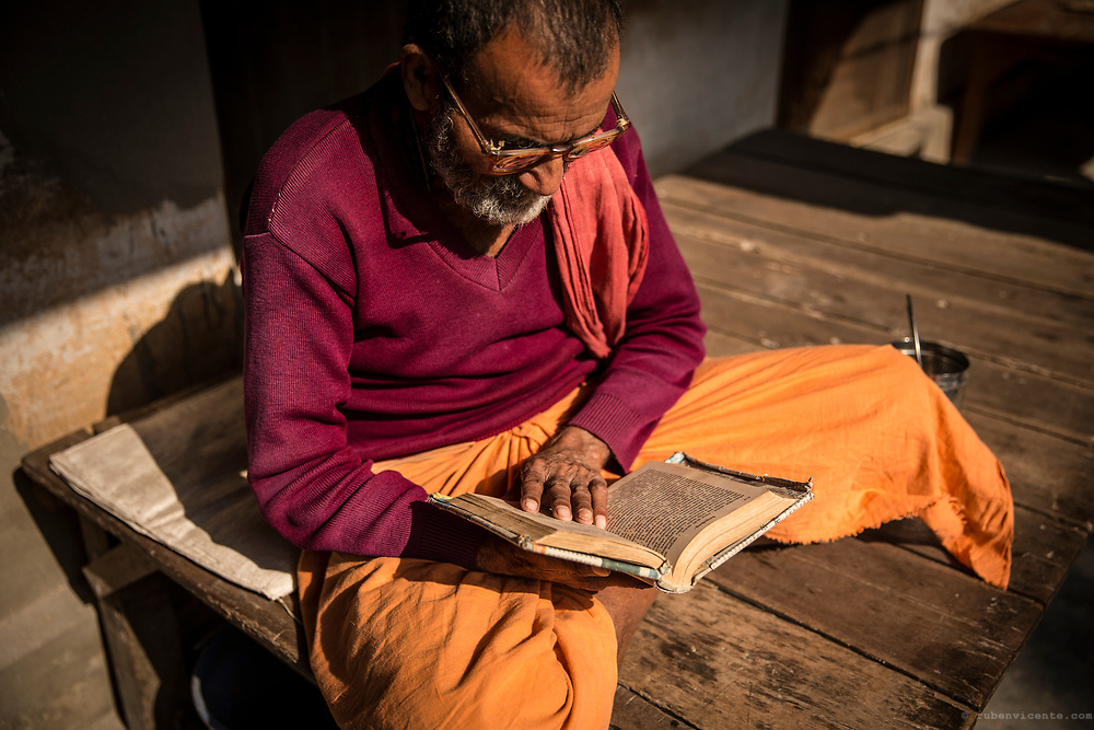 Dandi Swami sadhu sitting down studying. Varanasi, India