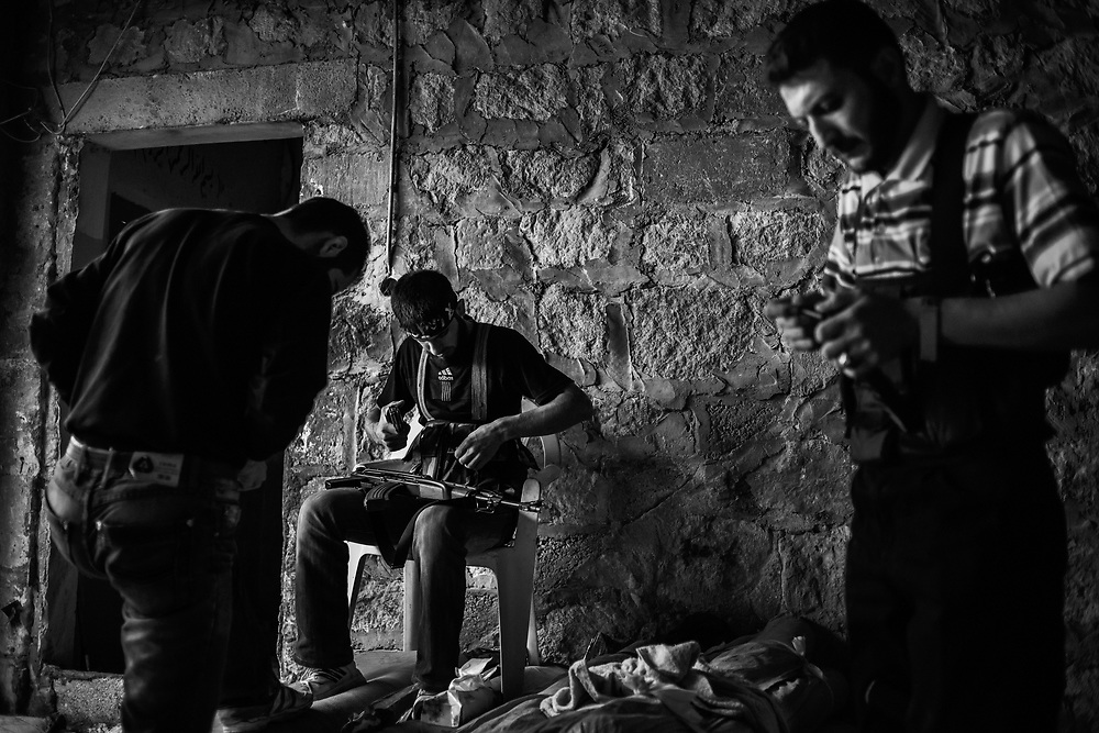Aleppo, Syria, Sunday 2012/10/21.<br /> Karm Al-Jabal district.<br /> FSA fighters load their weapons before facing off against loyalist army soldiers..