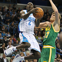 Feb 17, 2010; New Orleans, LA, USA; New Orleans Hornets guard Darren Collison (2) shoots over Utah Jazz forward Andrei Kirilenko (47) during the second quarter at the New Orleans Arena. Mandatory Credit: Derick E. Hingle-US PRESSWIRE