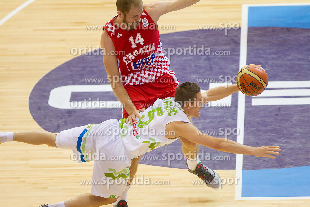 Luka Zoric #14 of Croatia vs Jaka Lakovic of Slovenia during basketball match between National teams of Slovenia and Croatia in Round 1 at Day 5 of Eurobasket 2013 on September 8, 2013 in Arena Zlatorog, Celje, Slovenia. (Photo by Vid Ponikvar / Sportida.com)