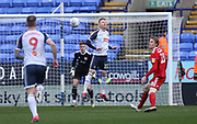 Bolton Wanderers Ali Crawford jumps for the ball during the EFL Sky Bet League 1 match between Bolton Wanderers and Accrington Stanley at the University of  Bolton Stadium, Bolton, England on 29 February 2020.