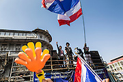 05 JANUARY 2014 - BANGKOK, THAILAND: A sound truck making anti-government announcements drives through the Little India neighborhood of Bangkok. Suthep Thaugsuband, leader of the anti-government protests in Bangkok, led the protestors on a march through the Chinatown district of Bangkok. Tens of thousands of people waving Thai flags and blowing whistles gridlocked what was already one of the most congested parts of the city. The march was intended to be a warm up to their plan by protestors to completely shut down Bangkok starting Jan. 13.     PHOTO BY JACK KURTZ