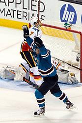 Jan 17, 2012; San Jose, CA, USA; San Jose Sharks left wing Torrey Mitchell (17) scores a goal past Calgary Flames goalie Miikka Kiprusoff (34) during the third period at HP Pavilion. San Jose defeated Calgary 2-1 in shootouts. Mandatory Credit: Jason O. Watson-US PRESSWIRE