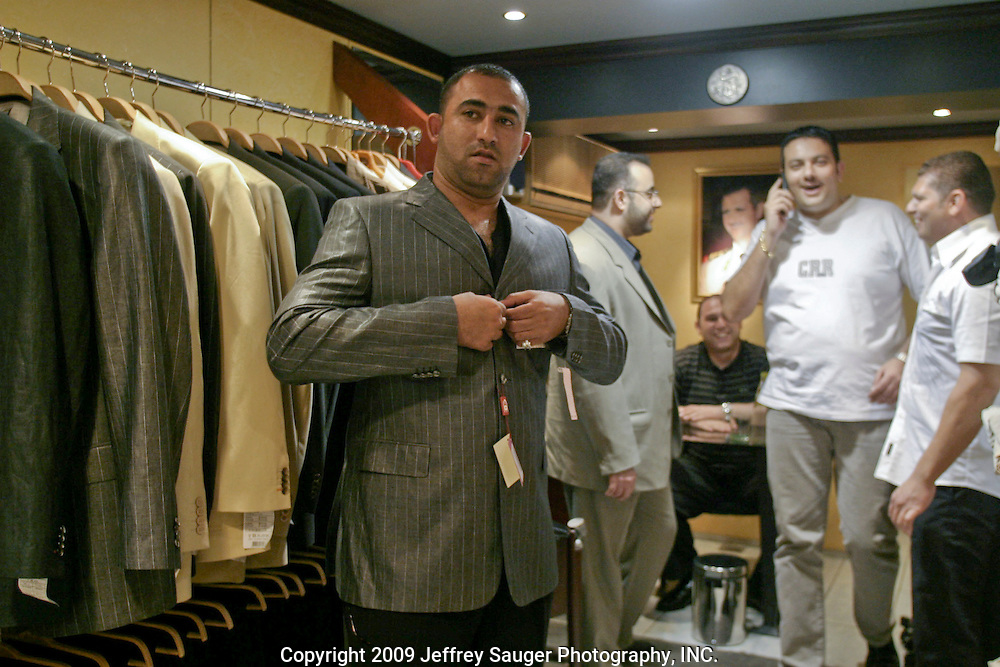 Haider Al-Jubury tries on a Syrian suit made of Italian fabric 140s in a shop in Abu Ramana, Damascus, Syria, Saturday, July 12, 2003. The suit cost 1500 Syrian lyra , or, $300 U.S. dollars. A similar suit in the U.S. would cost $2000 or more. A Syrian family could live for one month with $300 U.S. dollars. Al-Jubury and Emad Al-kasid have been been planning the trip home to Iraq, over the last year. They are visiting their immediate families in Damascus, Syria, as hundreds of thousands of Iraqi Shiite settled in Syria after the Gulf War and their uprising against Saddam Hussein in 1991.
