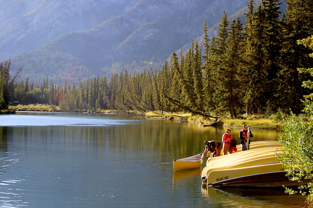 Canoeists leave Bow River, Banff Alberta