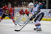 KELOWNA, CANADA - JANUARY 21:  Kelowna Rockets right wing Kole Lind #16, Portland Winterhawks defenseman Matthew Quigley #5 and Portland Winterhawks goalie Cole Kehler #31 at the Kelowna Rockets game on January 21, 2017 at Prospera Place in Kelowna, British Columbia, Canada.  (Photo By Cindy Rogers/Nyasa Photography,  *** Local Caption ***
