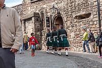 Boy observes small phalanx of Scottish soldiers at Edinburgh Castle, in Edinburgh, Scotland. Copyright 2019 Reid McNally.