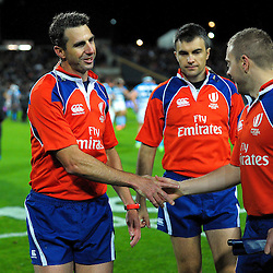 Referee Craig Joubert (left) shakes hands with Angus Gardner as Marius Mitrea looks on during The Rugby Championship match between the NZ All Blacks and Argentina Pumas at FMG Stadium in Hamilton, New Zealand on Saturday, 10 September 2016. Photo: Dave Lintott / lintottphoto.co.nz