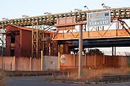 Taranto, 22/09/2012: Acciaieria ILVA, trasporto del minerale sull nastro trasportatore - ILVA steel factory, transport of minerals on the conveyor belt.<br /> &copy;Andrea Sabbadini