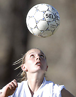 NEWS&GUIDE PHOTO / BRADLY J. BONER.Jackson freshman Nichole Rice eyes a high bounce while charging downfiled during the second half against Rock Springs on Friday afternoon.