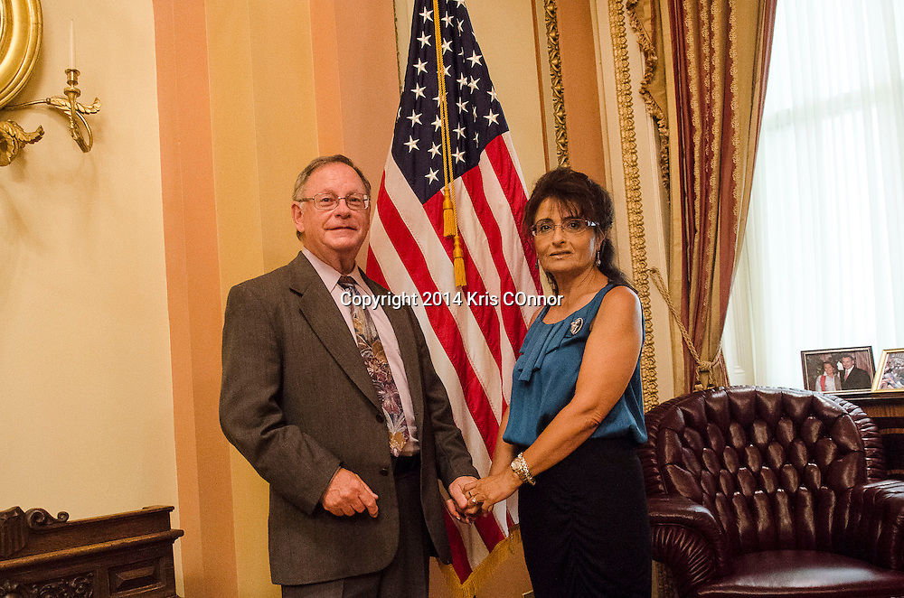 Rabbi Michael Lotker, and Sonia Lotker pose for a photo  in the Speaker's Lobby in the US Capitol before Michael gave the opening prayer during the opening ceremony of the House of Representatives on Capitol Hill in Washington DC on June 18, 2014. Photo by Kris Connor