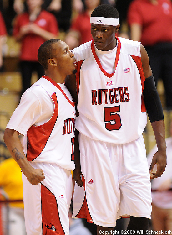 Feb 22, 2009; Piscataway, NJ, USA; Rutgers guard Corey Chandler (1) and Rutgers center Hamady N'Diaye (5) react to N'Diaye's forced turnover on a held ball during the second half of Rutgers' 74-56 loss to West Virginia at the Louis Brown Athletic Center.
