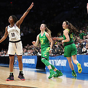 March 31, 2019; Portland, OR, USA;  Oregon Ducks guard Sabrina Ionescu (20) watches her three-point shot go in over Mississippi State Bulldogs guard Jazzmun Holmes (10) in the Elite Eight of the NCAA Women's Tournament at Moda Center.<br /> Photo by Jaime Valdez