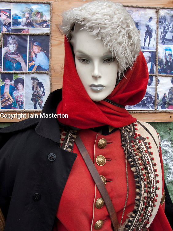 Mannequins modeling antique military uniforms outside shop in bohemian Prenzlauer district of Berlin 2009