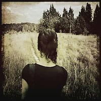 A woman walking across a field.