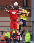 Leyton Orient striker Ollie Palmer and Oxford defender Jake Wright compete for a high ball during the Sky Bet League 2 match between Leyton Orient and Oxford United at the Matchroom Stadium, London, England on 17 October 2015. Photo by Bennett Dean.