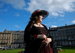 © Licensed to London News Pictures. <br /> 01/11/2014. <br /> <br /> Whitby, Yorkshire, United Kingdom<br /> <br /> Sarah Murray from Newcastle attends the 20th anniversary of the Whitby Goth Weekend.<br /> <br /> The event this weekend brings together thousands of extravagantly dressed followers of Victoriana, Steampunk, Cybergoth and Romanticism who all visit the town to take part in celebrating Gothic culture. This weekend marks the 20th anniversary since the event was started by local woman Jo Hampshire.<br /> <br /> Photo credit : Ian Forsyth/LNP
