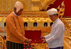 Myanmar's outgoing president U Thein Sein (R) hands over the presidential sash to Myanmar's new President U Htin Kyaw during the president power handover ceremony at the Presidential Palace in Nay Pyi Taw, Myanmar, March 30, 2016. Myanmar's new President U Htin Kyaw pledged on Wednesday to implement four policies based on the policies of the ruling National League for Democracy (NLD), led by Aung San Suu Kyi. EXPA Pictures © 2016, PhotoCredit: EXPA/ Photoshot/ MOI<br /> <br /> *****ATTENTION - for AUT, SLO, CRO, SRB, BIH, MAZ, SUI only*****
