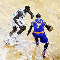26 April 2013: New York Knicks small forward Carmelo Anthony (7) drives past Boston Celtics power forward Brandon Bass (30) during Game Three of the Eastern Conference Quarterfinals of the 2013 NBA Playoffs at the TD Garden, Boston, Massachusetts, USA.