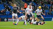 Jack O'Connell (Brentford) gets to the ball just in front of Dorian Dervite (Bolton) to clear the corner  during the Sky Bet Championship match between Bolton Wanderers and Brentford at the Macron Stadium, Bolton, England on 30 November 2015. Photo by Mark P Doherty.