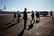 GOP presidential candidate Mitt Romney is surrounded by Secret Service agents as he walks to his plane in Elko, Nevada, February 3, 20112.