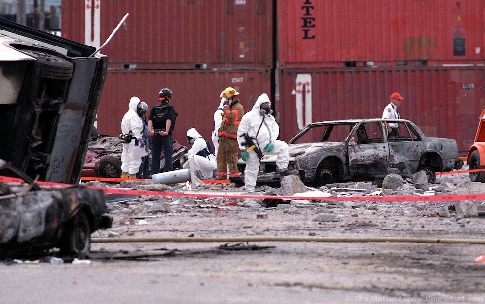 Federal agents pretend to measure radiation levels in what has become a mock crime scene during the national terrorism excercise titled TopOff2 on Monday, May 12, 2003, in Seattle, Washington. TopOff2 is intended to test the national response to a terrorist attack.