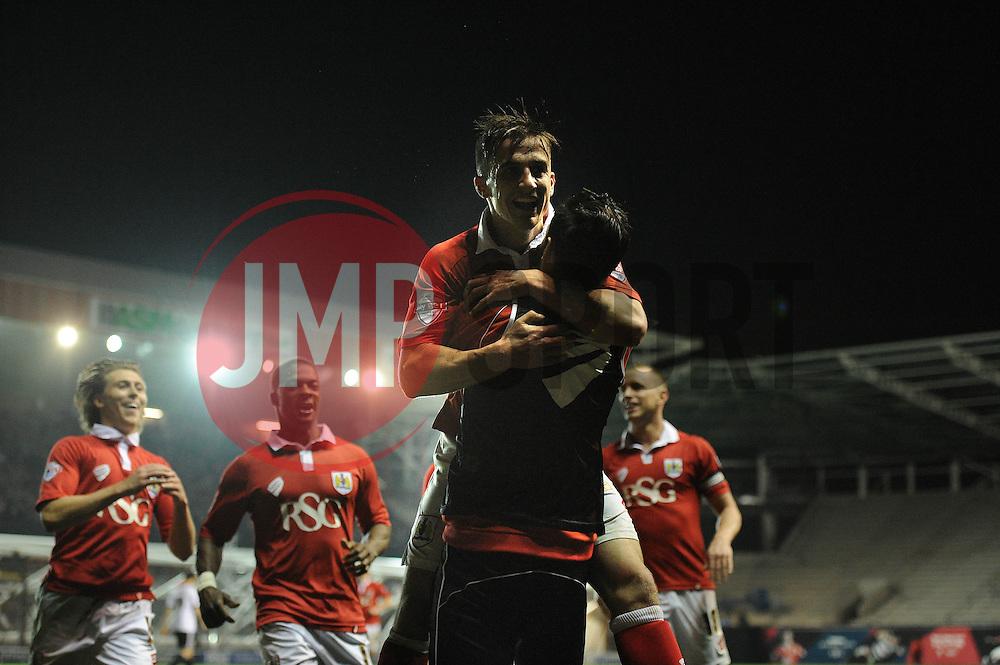 Bristol City's Joe Bryan celebrates his goal with Bristol City's Greg Cunningham - Photo mandatory by-line: Dougie Allward/JMP - Mobile: 07966 386802 - 07/04/2015 - SPORT - Football - Bristol - Ashton Gate - Bristol City v Swindon Town - Sky Bet League One