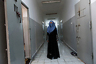 Libya, Misurata: A woman who claims to have being used as sex slaves by ISIS member in Sirte is seen inside her cell at the Libyan airforce compound in Misurata. Alessio Romenzi
