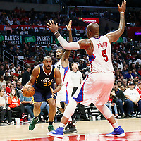 25 March 2016: Utah Jazz center Boris Diaw (33) drives past LA Clippers guard Jamal Crawford (11) during the Los Angeles Clippers 108-95 victory over the Utah Jazz, at the Staples Center, Los Angeles, California, USA.