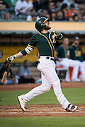 Oakland Athletics second baseman Jed Lowrie (8) reacts to popping out against the San Francisco Giants at Oakland Coliseum in Oakland, California, on August 1, 2017. (Stan Olszewski/Special to S.F. Examiner)