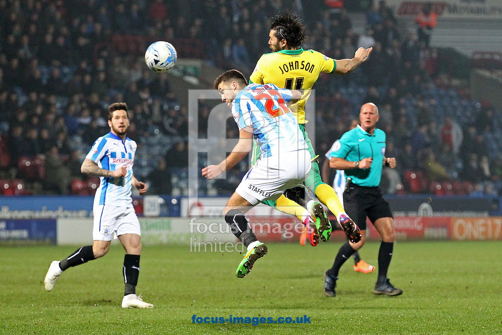 Bradley Johnson of Norwich heads for goal during the Sky Bet Championship match at the John Smiths Stadium, Huddersfield<br /> Picture by Paul Chesterton/Focus Images Ltd +44 7904 640267<br /> 17/03/2015
