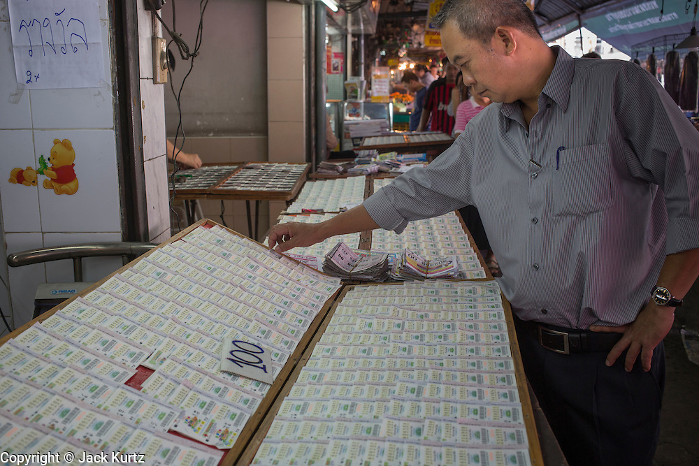 03 JANUARY 2013 - BANGKOK, THAILAND:  People buy lottery tickets at lottery shops along Sukhumvit Soi 77 in Bangkok. About 20 million Thais, nearly ⅓ of the country's 65 million people, play lottery type games. The lotteries were brought to Thailand two hundred years ago by Chinese immigrants. Lottery agents are usually friends who collect bets but do not ask for money before the drawing.   PHOTO BY JACK KURTZ