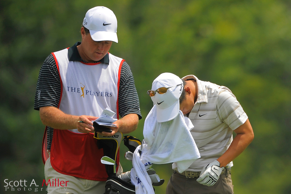 Anthony Kim swipes his face as he waits on the 14th hole during the second round of the Players Championship at TPC Sawgrass on May 9, 2008 in Ponte Vedra Beach, Florida.     © 2008 Scott A. Miller