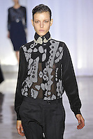Tati Cotliar walks the runway wearing Preen Fall 2011 Collection during Mercedes-Benz Fashion Week in New York on February 13, 2011