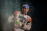 Klaus Graf, Muscle Milk Pickett Racing (P1) celebrates on the podium Petit Le Mans. Oct 18-20, 2012. © Jamey Price
