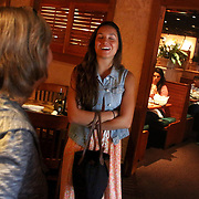 Tania Tayloe, left and Rachael Gallelli share a laugh while waiting for the Parrish family to show up at Carrabba's Italian Grill. (Jason A. Frizzelle)