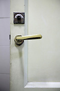 old style toilet door lock sign and handle