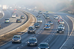 © Licensed to London News Pictures. 24/12/2018. Crockenhill, UK.M25 traffic near Swanley. Christmas eve misty sunny weather this morning as people finish up for Christmas day. Photo credit: Grant Falvey/LNP