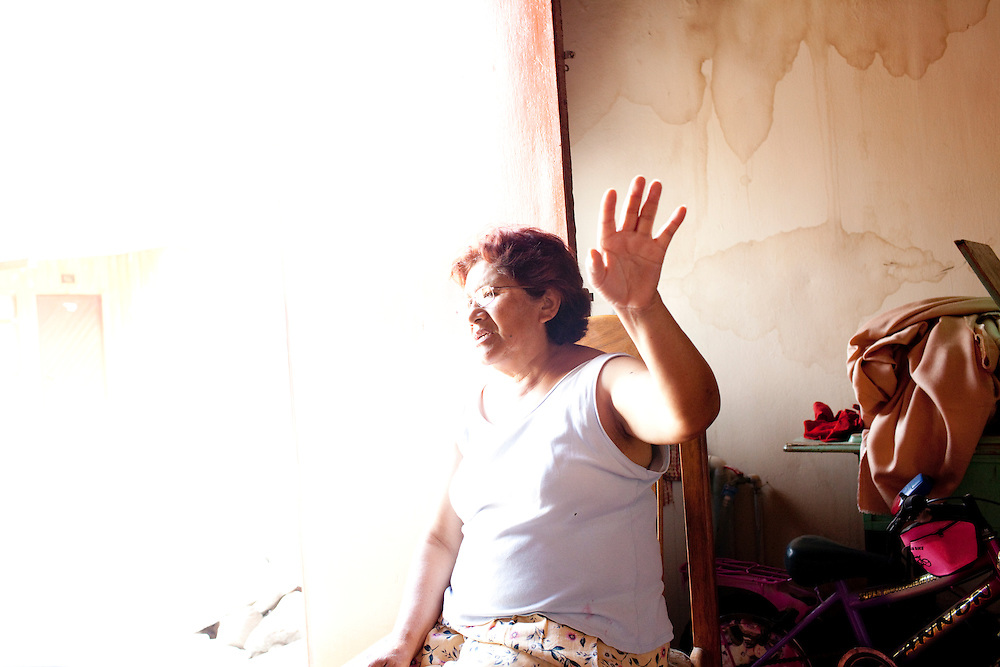 A woman in her home on Monday, Apr. 6, 2009 in Ventanilla, Peru.