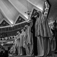 Muslim women pray at National Mosque in Kuala Lumpur, Malaysia.