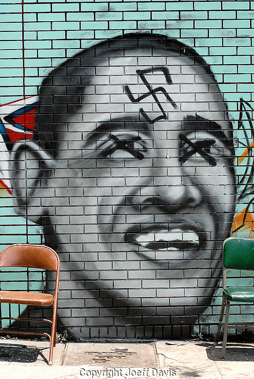 Someone spray-painted a swastika and X's last night over this graffiti portrait of Barack Obama in Little Five Points. <br />