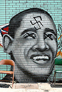 Someone spray-painted a swastika and X's last night over this graffiti portrait of Barack Obama in Little Five Points. <br /> <br /> Camron Wiltshire and two other artists had been working since last week on the piece at the corner of Colquitt and Euclid avenues. Wiltshire came by today to put the finishing touches on his portrait and discovered the swastika. <br /> <br /> &quot;Nothing stops love,&quot; Wiltshire said. &quot;The person who did it is forgiven. And if he'd like to come talk to me, I am open to it. And I hope as a collective humanity can evolve and learn to love each other.&quot;