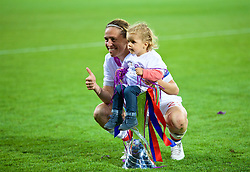 CARDIFF, WALES - Thursday, June 1, 2017: Olympique Lyonnais' Camille Abily celebrates with a child after winning the UEFA Women's Champions League Final between Olympique Lyonnais and Paris Saint-Germain FC at the Cardiff City Stadium. (Pic by David Rawcliffe/Propaganda)