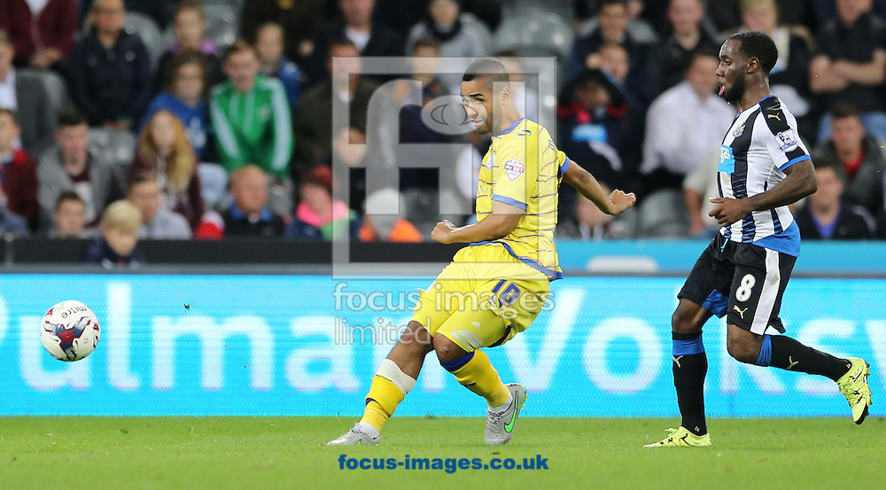 Vurnon Anita (r) of Newcastle United and Lewis McGugan of Sheffield Wednesday during the Capital One Cup match at St. James's Park, Newcastle<br /> Picture by Simon Moore/Focus Images Ltd 07807 671782<br /> 23/09/2015