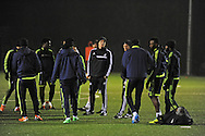 Swansea city Manager Garry Monk (c) taking Swansea city FC team training in Landore, Swansea, South Wales on Wed 19th Feb 2014. the team are training ahead of tomorrow's UEFA Europa league match against Napoli.<br /> pic by Phil Rees, Andrew Orchard sports photography.