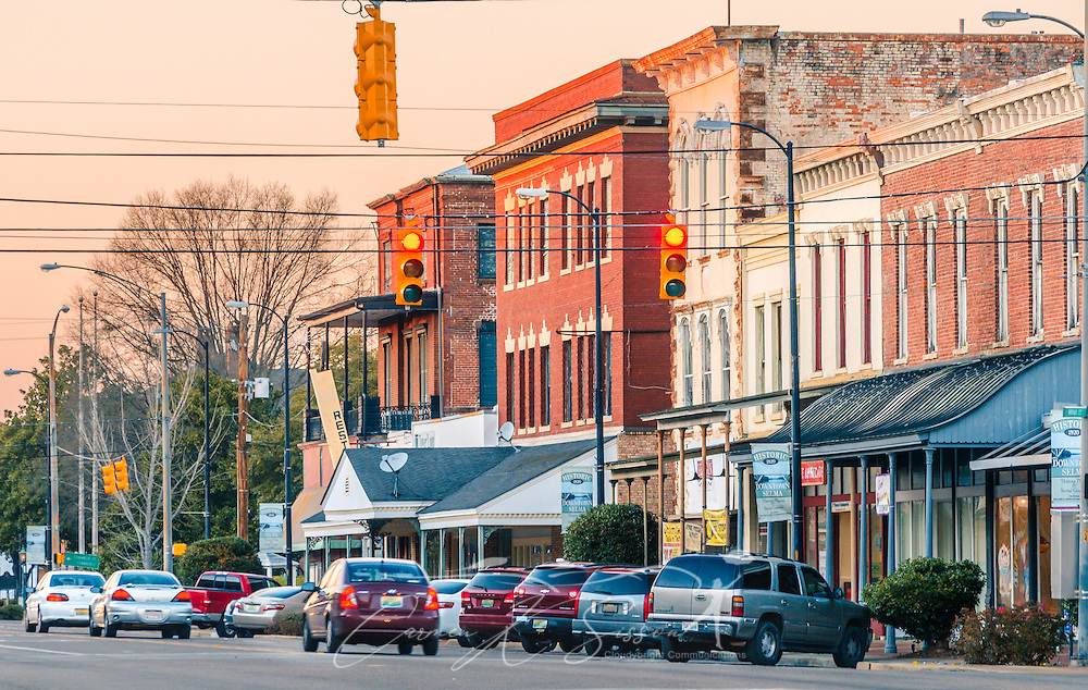 Cars travel down Broad Street as the sun sets on downtown, Feb. 14, 2015, in Selma, Alabama. (Photo by Carmen K. Sisson/Cloudybright)