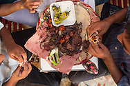Carnitas, grilled meat served with sides of salsa and grilled vegetables, Oaxaca, Mexico